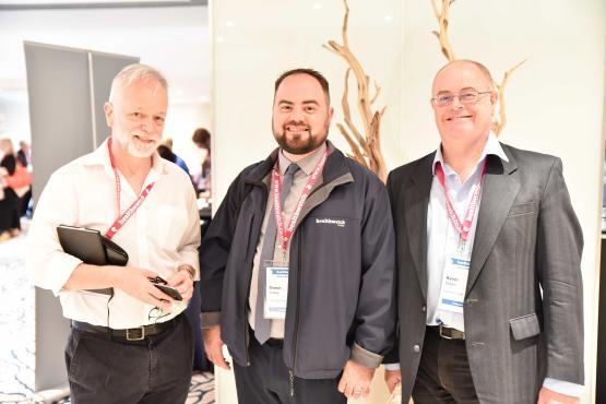 Three board members stood together